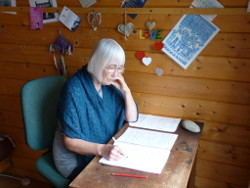 The author at work in her cabin.
